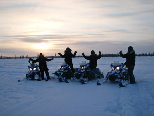 Guests on Snow mobile safari in Lapland