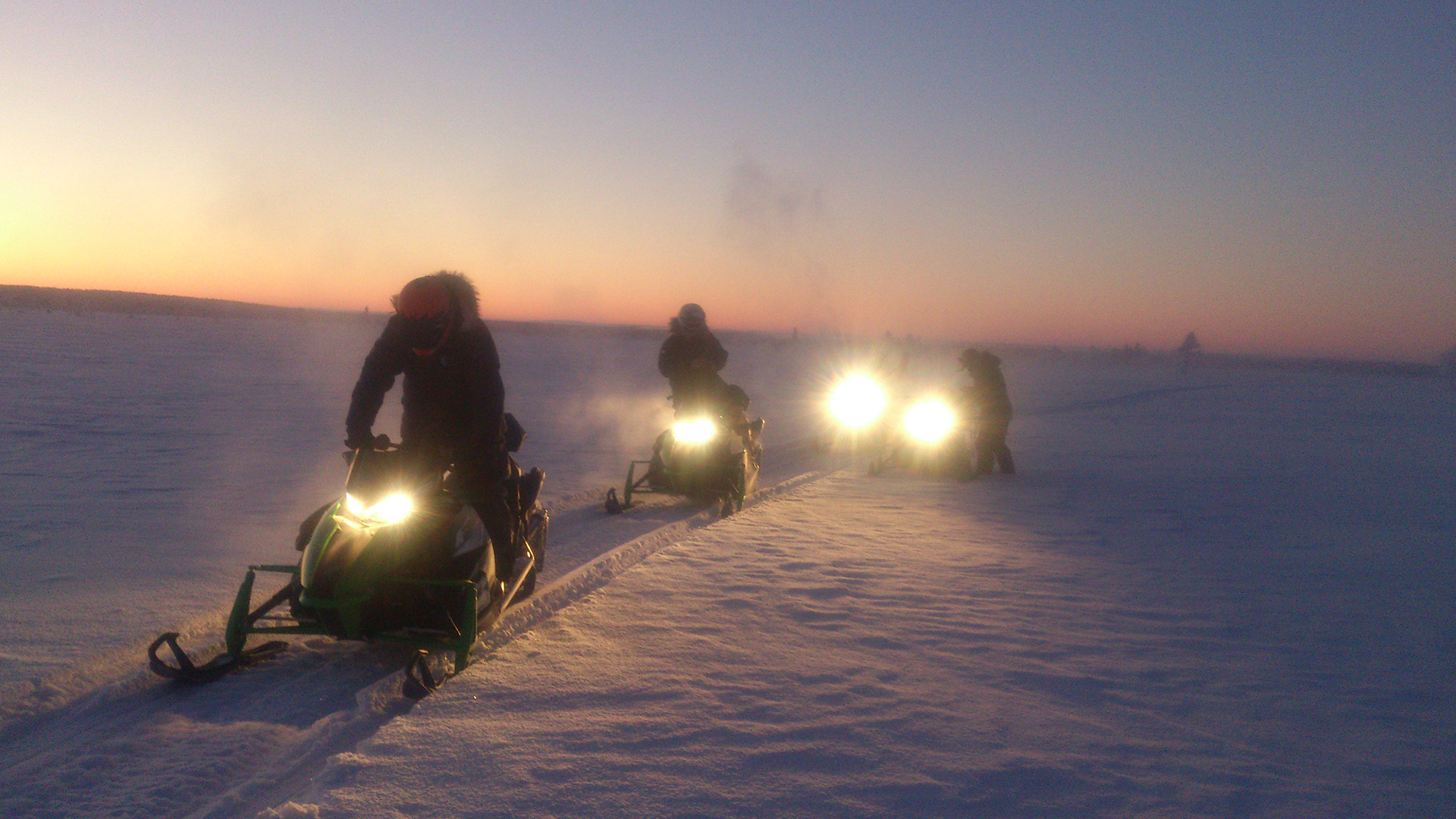 Snowbobile safari in dusk - Lapland