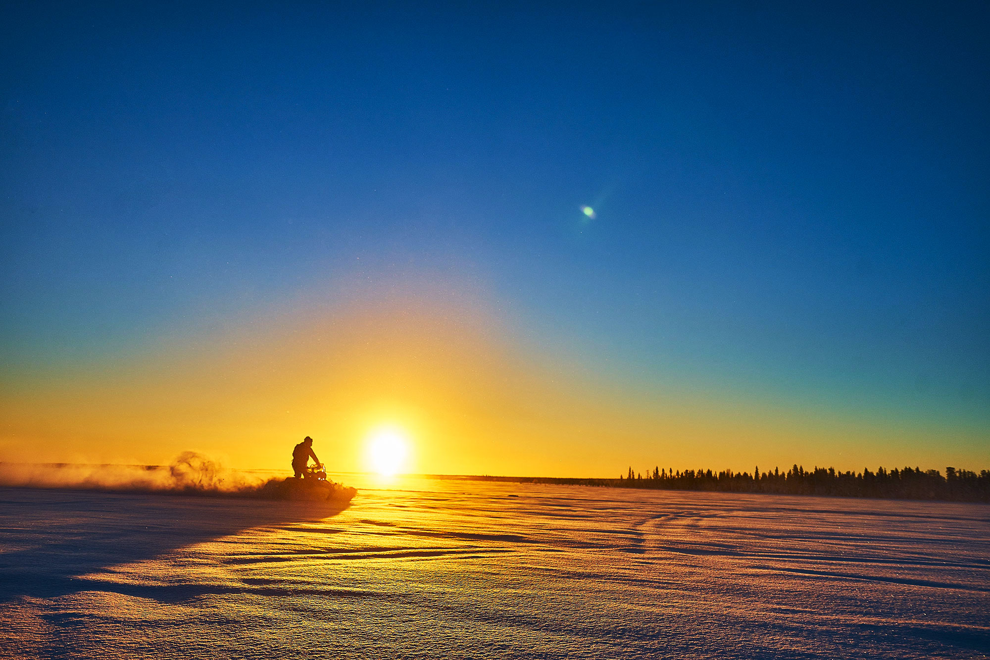 Sunset Snow Mobile